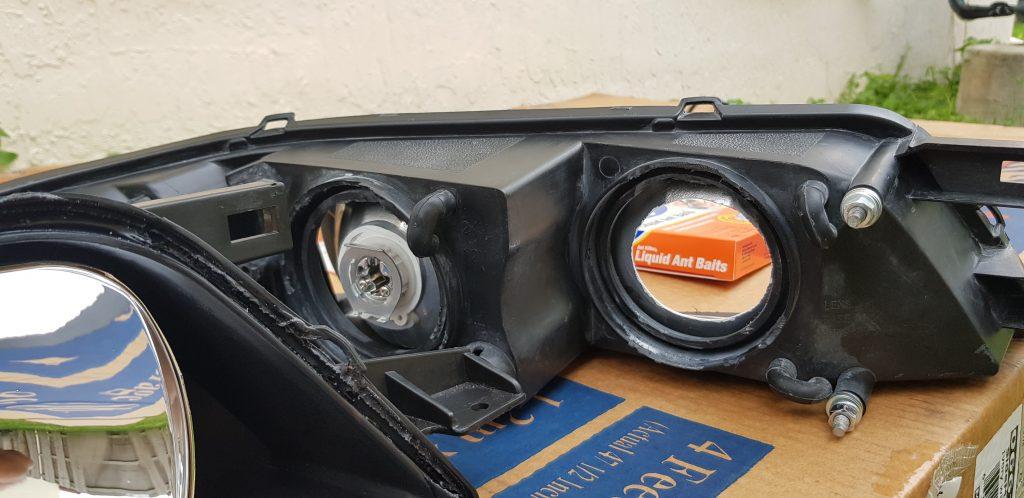 R34 Nissan Maxima head lights modified for mini H1 projectors.