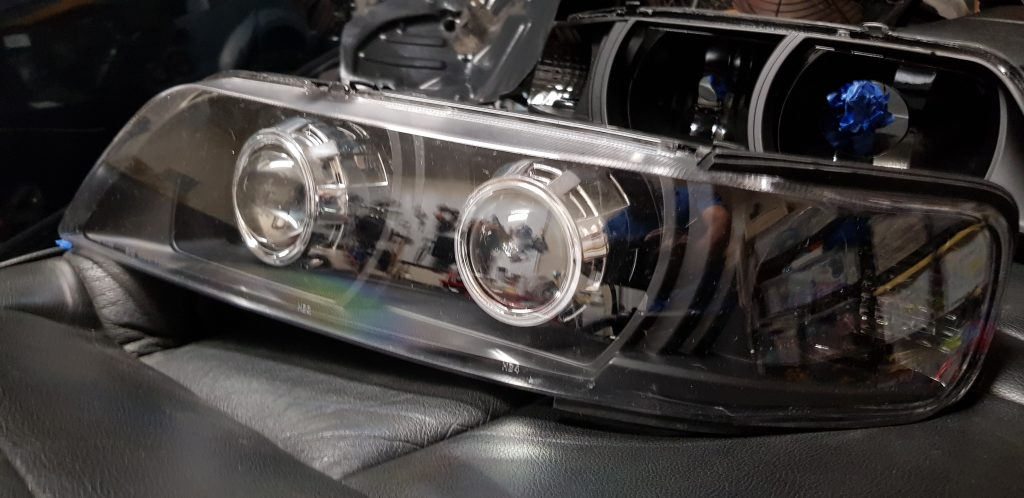 R34 Nissan Maxima head lights with mini h1 projectors.